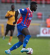 Dagenham player Ayo Obileye on the ball during the Sky Bet League 2 match between Dagenham and Redbridge and Newport County at the London Borough of Barking and Dagenham Stadium, London, England on 19 September 2015. Photo by Bennett Dean.