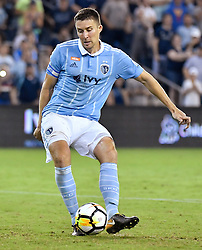 Sporting Kansas City defender Matt Besler makes the final penalty kick against the San Jose Earthquakes during the U.S. Open Cup semifinals at Children's Mercy Park in Kansas City, Kan., on Wednesday, Aug. 9, 2017. Sporting KC advanced on penalty kicks, 5-4, after the teams tied, 1-1, in regulation. (Photo by John Sleezer/Kansas City Star/TNS/Sipa USA) *** Please Use Credit from Credit Field ***