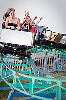 """JEROME A. POLLOS/Press..Felicia and Rheana having fun on the mini coaster at the fair on Sunday, August 30, 2009. Felicia didn't want to ride the """"kiddie"""" ride because she wouldn't have fun. This is Rheana's favorite ride. Both had fun."""