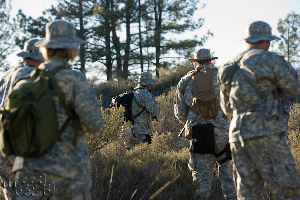 US army soldiers during training in forest, selective focus