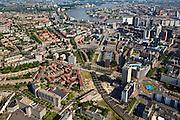 Nederland, Zuid-Holland, Rotterdam, 23-05-2011;.Overzicht Rotterdam in oostelijke richting.In de verte is de Van Brienenoordbrug (A16) te zien..Te zien zijn: Hofplein (b,r), Pompenburg, spoorbaan van voormalige Hofpleinlijn, Goudsesingel (richting rivier), Coolsingel, Stadhuis, Beurs-World Trade Center, Croosweijk(links) Aan de rivier het witte gebouw van Nedlloyf, daarachter Noordereiland en Zuid. Willemsbrug over de Nieuwe Maas..View on the center of Rotterdam eastwards. Hofplein, railway of former station Hofplein, City Hall at the Coolsingel, Willensbrug, in the distance the Van Brienenoordbrug (A16)..luchtfoto (toeslag), aerial photo (additional fee required).copyright foto/photo Siebe Swart