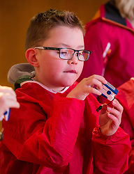 City Arts Centre, Edinburgh, Scotland, United Kingdom, 9 April 2019. Edinburgh Science Festival:  Jamie Carter, age 8 years, has fun learning about blood at the Blood Bar drop in event at the Science Festival. <br /> <br /> Sally Anderson | EdinburghElitemedia.co.uk