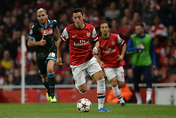 LONDON, ENGLAND - Oct 01: Arsenal's midfielder Mesut Ozil from Germany runs with the ball during the UEFA Champions League match between Arsenal from England and Napoli from Italy played at The Emirates Stadium, on October 01, 2013 in London, England. (Photo by Mitchell Gunn/ESPA)