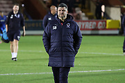 AFC Wimbledon first team coach Simon Bassey walking onto the pitch during the EFL Trophy group stage match between AFC Wimbledon and Stevenage at the Cherry Red Records Stadium, Kingston, England on 6 November 2018.