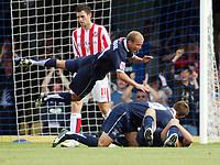 Photo: Chris Ratcliffe.<br />Southend United v Sunderland. Coca Cola Championship. 19/08/2006.<br />Luke Guttridge jumps on goalscorer Lee Bradbury as they celebrate scoring the third Southend  goal.