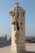 Statue of King John III or Joao III, 1502-57, who based the University permanently in Coimbra in 1537, by Francisco Franco, erected in 1950, on the Paco das Escolas or Palace of the Schools complex at the University of Coimbra, Coimbra, Portugal. The University of Coimbra was first founded in 1290 and moved to Coimbra in 1308 and to the royal palace in 1537. The buildings are listed as a historic monument and a UNESCO World Heritage Site. Picture by Manuel Cohen