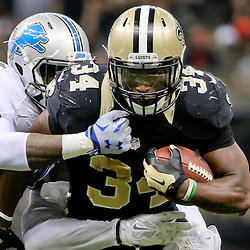 Dec 21, 2015; New Orleans, LA, USA; New Orleans Saints running back Tim Hightower (34) runs against the Detroit Lions during the second half of a game at the Mercedes-Benz Superdome. The Lions defeated the Saints 35-27. Mandatory Credit: Derick E. Hingle-USA TODAY Sports