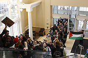 Student march through Baker Center during the #HandsUpWalkOut march.Photo by Olivia Wallace
