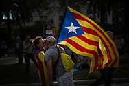 Spain, Barcelona: A couple kisses each other while they hold a Catalan flag in Barcelona, Spain, Tuesday Oct. 10, 2017.Catalan President Puigdemont has proposed to suspend Catalonia's declaration of independence for few weeks to hold talks with Spanish government.