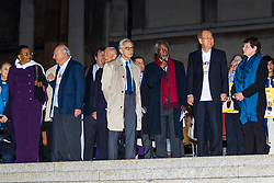 "London, October 23 2017. Nelson Mandela's group of Elders including former UN Secretary General Kofi Annan and Secretary General Ban Ki-moon accompanied by his widow Graca Machel gather at Parliament Square at the start of the Walk Together event in memory of Nelson Mandela before a candlelight vigil at his statue in Parliament Square. ""WalkTogether is a global campaign to inspire hope and compassion, celebrating communities working for the freedoms that unite us"". PICTURED:  Former leaders including Ban Ki-moon, Kofi Annan, Mary Robinson, Gro Harlem Brundtland, Lakhdar Brahimi and Martti Ahtisaari. © Paul Davey"