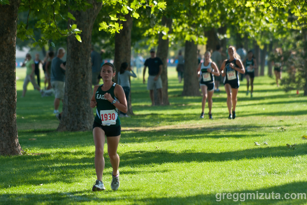 Eagle junior Madeleine Roberts separates from the field during the Roger Curran Memorial Run girl's junior varsity 5k race at West Park in Nampa, ID on September 10, 2011. Roberts won the race with a time of 21:11.19.