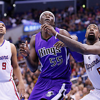 23 November 2013: Sacramento Kings center Hamady Ndiaye (55) vies for the rebound with Los Angeles Clippers center DeAndre Jordan (6) during the Los Angeles Clippers 103-102 victory over the Sacramento Kings at the Staples Center, Los Angeles, California, USA.