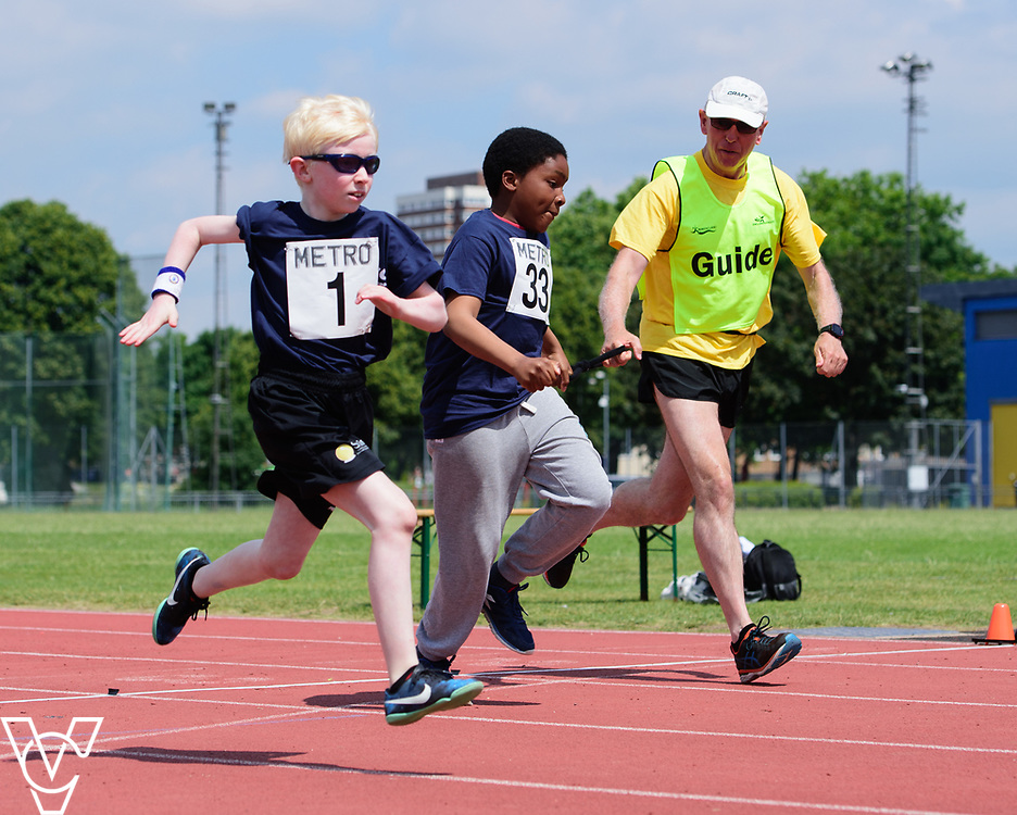Metro Blind Sport's 2017 Athletics Open held at Mile End Stadium.  60m.  From left, Harry Hughes and Clinton Njoku with guide runner<br /> <br /> Picture: Chris Vaughan Photography for Metro Blind Sport<br /> Date: June 17, 2017
