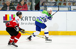 Manuel Geier of Austria vs Rok Ticar of Slovenia in action during ice hockey match between National Teams of Austria and Slovenia in 5th Round of 2016 IIHF Ice Hockey World Championship Division 1 - Group A, on April 29, 2016 in Spodek Arena, Katowice, Poland. Photo by Marek Piuyzs / Sportida