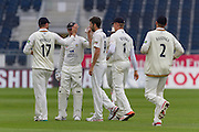 Graham Onions(Durham County Cricket Club) is congratulated by team mates after taking the wicket of Jeetan Patel (Warwickshire County Cricket Club) during the LV County Championship Div 1 match between Durham County Cricket Club and Warwickshire County Cricket Club at the Emirates Durham ICG Ground, Chester-le-Street, United Kingdom on 14 July 2015. Photo by George Ledger.