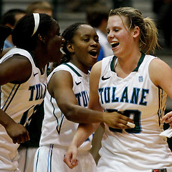November 19, 2011; New Orleans, LA; Tulane Green Wave forward Adesuwa Ebomwonyi (15) and guard Tyria Snow (25) celebrate with forward Danielle Blagg (20) who scored the game winning shot during the overtime of a game against the LSU Lady Tigers at Avron B. Fogelman Arena. Tulane defeated LSU 65-62 in overtime. Mandatory Credit: Derick E. Hingle-US PRESSWIRE