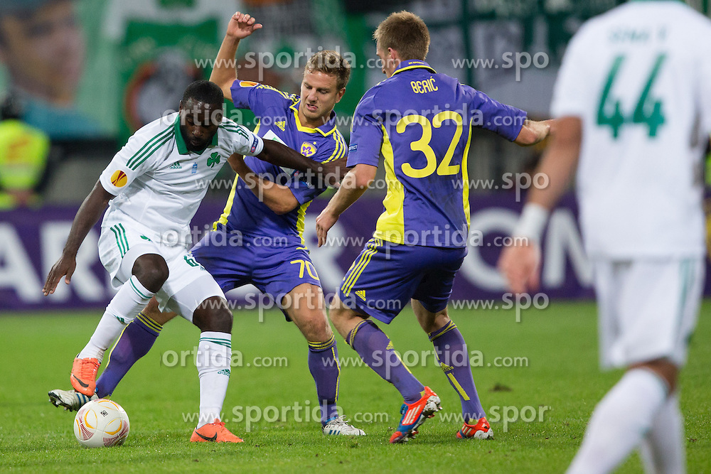 Quincy Owusu-Abeyle of Panathinaikos vs Ales Mertelj of NK Maribor and Robert Beric of NK Maribor during football match between NK Maribor and Panathinaikos Athens F.C. (GRE) in 1st Round of Group Stage of UEFA Europa league 2013, on September 20, 2012 in Stadium Ljudski vrt, Maribor, Slovenia. (Photo By Matic Klansek Velej / Sportida)