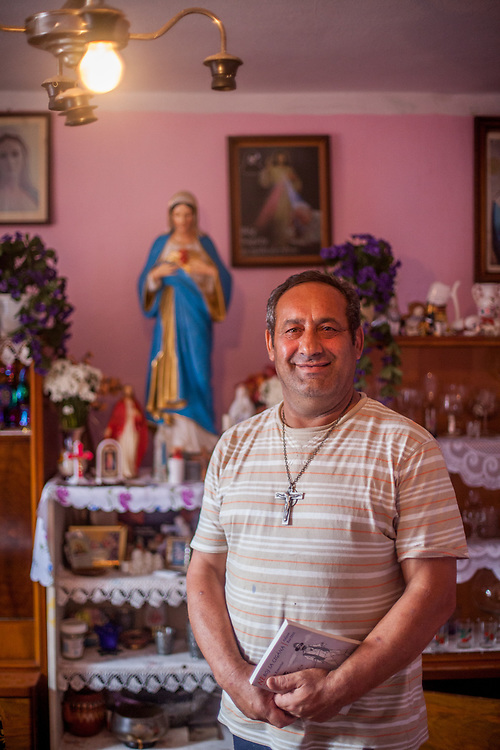 Portrait of Julius Korckovsky in his house at the Roma settlement (2014). He is deeply religious and believes that god is helping him to improve his own community and the living conditions in the settlement - since a long time he is working hard to accomplish that. Stara Lubovna is located about 100 km from Kosice in northeast Slovakia.