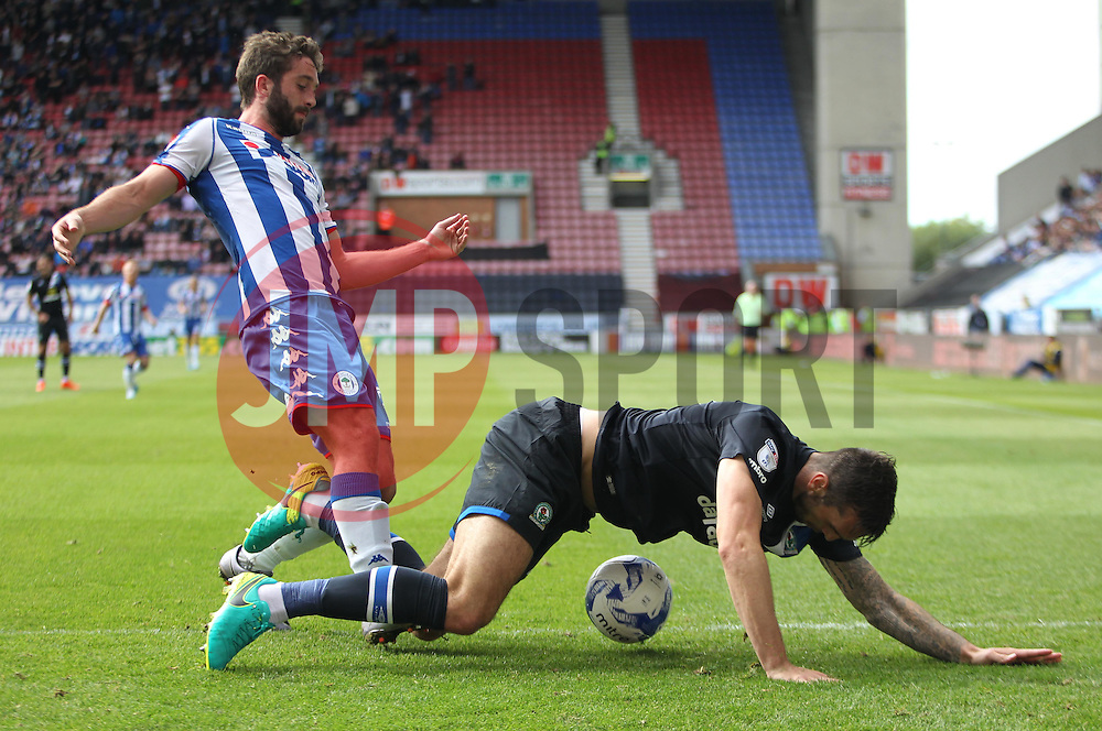 Will Grigg of Wigan Athletic (L) and Shane Duffy of Blackburn Rovers in action - Mandatory by-line: Jack Phillips/JMP - 13/08/2016 - FOOTBALL - DW Stadium - Wigan, England - Wigan Athletic v Blackburn Rovers - EFL Sky Bet Championship