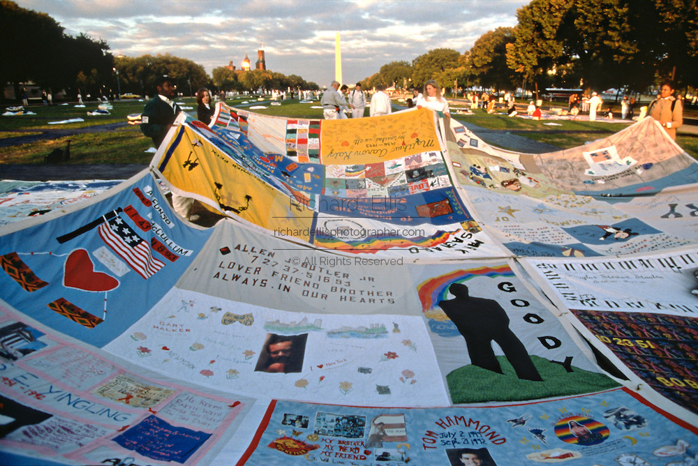Volunteers spread the entire AIDS Memorial Quilt out along the National Mall October 11, 1996 in Washington, DC.