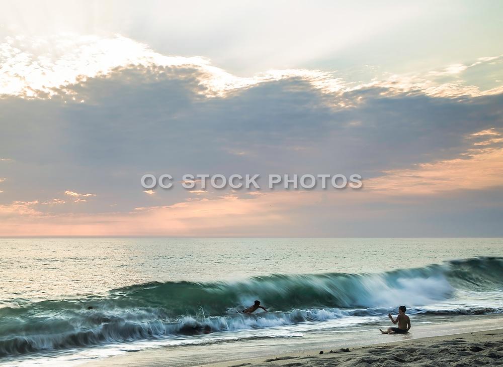 Kids Playing In The Waves At Tamarac Beach In Carlsbad California