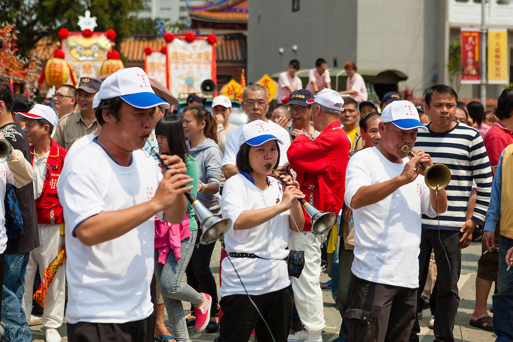 Musicians blow on a suona, a type of oboe, during a festival to mark the Bao Sheng Emperor's birthday in Taipei, Taiwan.