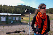 Gabrielle Pétron, a climate scientist from the University of Colorado Boulder, working in NOAA's Earth System Research Laboratory, monitors methane levels along South Fork Texas Creek, Bayfield, Colorado, using the NOAA mobile Laboratory.