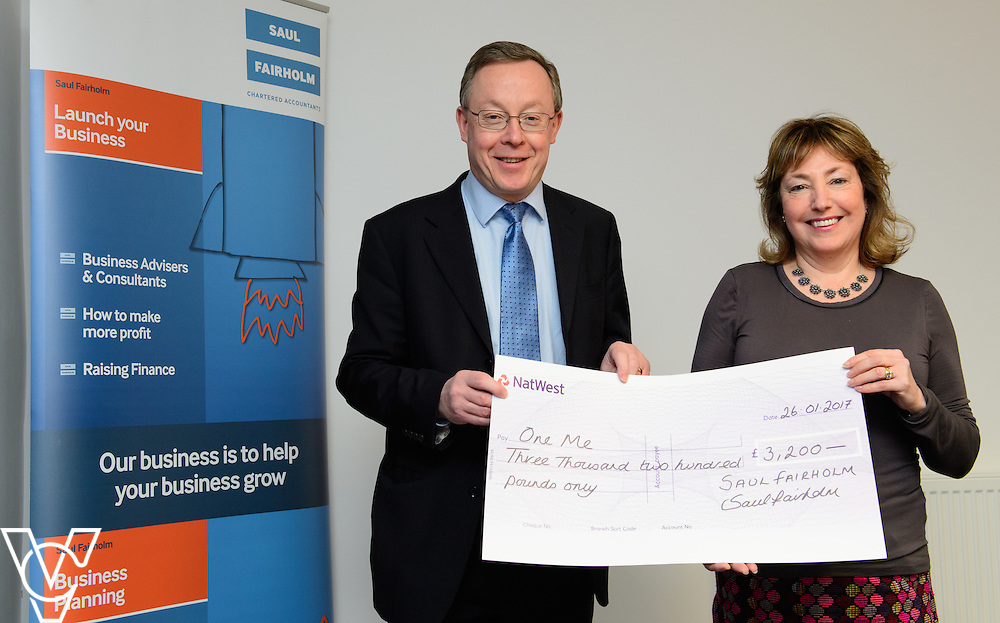Saul Fairholm director Stephen Tointon, left, presents a cheque to one me trustee Mel Holliday for &pound;3200.  one me is one of Saul Fairholm's charities of the year.<br /> <br /> Picture: Chris Vaughan Photography<br /> Date: January 26, 2016