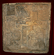 Yaxchilan lintel 15Maya, Late Classic period (AD 600-900) From Yaxchilan, Mexico. A serpent apparition from a Maya temple, limestone lintel, one of a series of three panels commissioned by Bird Jaguar IV for Structure 21 at Yaxchilan. The lintel shows one of Bird Jaguar's wives, Lady Wak Tuun, during a bloodletting rite. The Vision Serpent appears before her