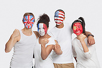 Portrait of happy Multi-ethnic group of friends with various national flags painted on their faces celebrating success against white background