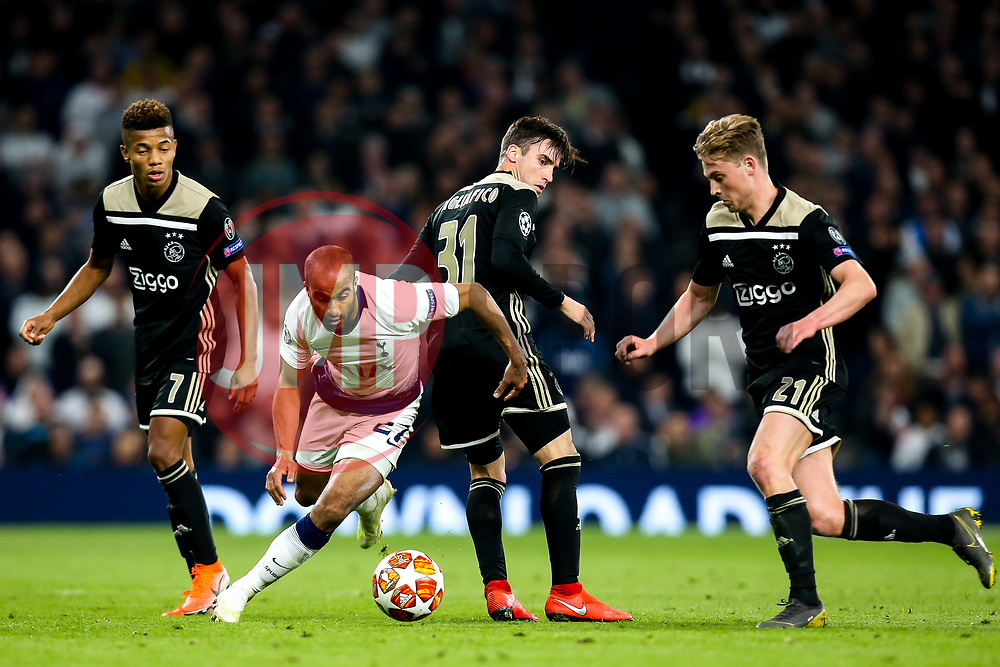 Lucas of Tottenham Hotspur takes on Nicolas Tagliafico of Ajax - Mandatory by-line: Robbie Stephenson/JMP - 30/04/2019 - FOOTBALL - Tottenham Hotspur Stadium - London, England - Tottenham Hotspur v Ajax - UEFA Champions League Semi-Final 1st Leg