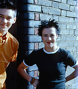 Girl and Boy Smiling by a Wall, Golders Green, London, UK, 1980s.