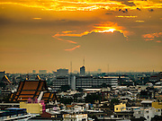20 NOVEMBER 2015 - BANGKOK, THAILAND: Looking west. The skyline of the city of Bangkok as seen from the top of Wat Saket, also known as the Golden Mount, a historic Buddhist temple in Bangkok.     PHOTO BY JACK KURTZ