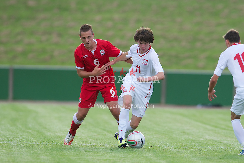 COLWYN BAY, WALES - Tuesday, August 28, 2012: Wales' Shane Parry in action against Poland's Adam Ryczkowski during the International Friendly Under-16's match at Eirias Park. (Pic by David Rawcliffe/Propaganda)