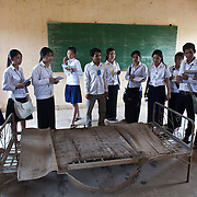 Cambodian High School students from Kampong Cham, Cambodia, view a rusting metal bed used to torture prisoners of the Khmer Rouge  during a tour of Toul Sleng Genocide Museum Sunday, March 29, 2009, in Phnom Penh, Cambodia.  During the Khmer Rouge reign more than 1.5 million Cambodians were killed as the result of execution, forced labor, starvation and disease.