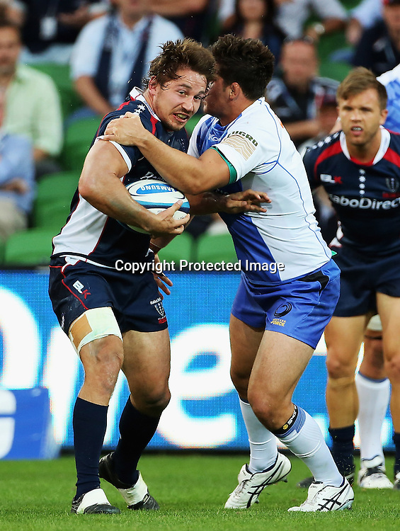 Scott Fuglistaller of the Rebels is tackled by Nathan Charles of the Force during the Rebels v Force Super Rugby Round 1 match at AAMI Park, Melbourne, Australia. Friday, 15 February, 2013. Photo: Hamish Blair/PHOTOSPORT