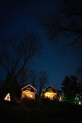 Historic kit houses decorated for the holidays, shot at dusk, in Oella, Maryland.