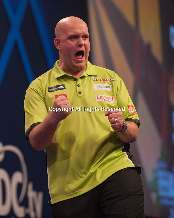 01.01.2014.  London, England.  William Hill World Darts Championship.  Quarter Final Round.  Michael van Gerwen (1) [NED] celebrates a winning leg in his match with Robert Thornton (9) [SCO]