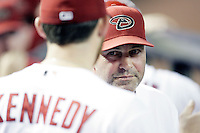 27 June 2011: Manager Kirk Gibson talking to pitcher Ian Kennedy between innings in the dugout during a Major League Baseball game MLB Cleveland Indians defeated the Arizona Diamondbacks 5-4 inside Chase Field in Phoenix, AZ.  **Editorial Use Only**