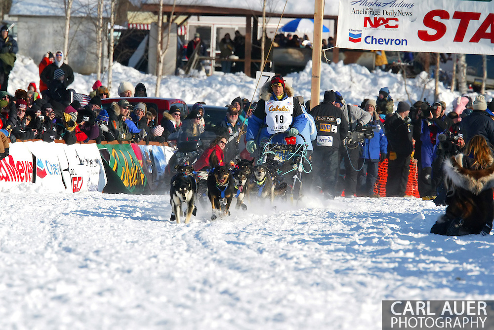 3/4/2007:  Willow, Alaska -  Alaskan favorite, Veteran Martin Buser of Big Lake, AK, barks out commands to his dogs as he starts the long trip to Nome in the 35th Iditarod Sled Dog Race