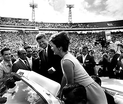John F. Kennedy, the nation's 35th President, would have turned 100 years old on May 29, 2017. With the centennial anniversary of John F. Kennedy's birth, the former president's legacy is being celebrated across the nation. PICTURED: U.S. - President JOHN F. KENNEDY and first lady JACKIE KENNEDY greeting a crowd in stadium while riding in open limousine. Date place unknown. (Credit Image: © John F. Kennedy Library/ZUMAPRESS.com)