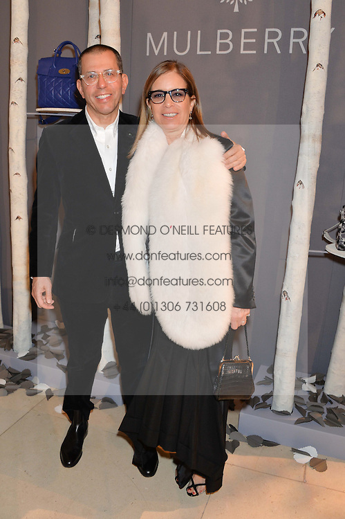 Condé Nast International Chairman and Chief Executive JONATHAN NEWHOUSE and his wife RONNIE at a Dinner to celebrate the launch of the Mulberry Cara Delevingne Collection held at Claridge's, Brook Street, London on 16th February 2014.