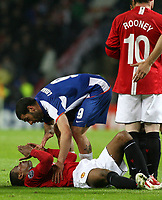 20090415: PORTO, PORTUGAL - FC Porto vs Manchester United: Champions League 2008/2009 – Quarter Finals – 2nd leg. In picture: Lisandro Lopez and Evra (injured). PHOTO: Manuel Azevedo/CITYFILES