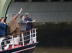 London Bridge, London, June 15th 2016. A flotilla of fishing boats led by UKIP's Nigel Farage heads through Tower Bridge in protest against the EU's Common Fisheries Policy and in support of Britain leaving the EU. PICTURED: A man makes an obscene gesture from Farage's boat at Remain campaigners on Westminster Bridge.