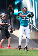 Oct 13, 2019; Jacksonville, FL USA;  Jacksonville Jaguars defensive end Calais Campbell (93) celebrates while coming out of the tunnel befpre an NFL game against the New Orleans Saints at TIAA Bank Field in Jacksonville, FL. The Saints beat the Jaguars 13-6. (Steve Jacobson/Image of Sport)
