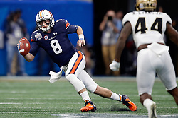 Auburn Tigers quarterback Jarrett Stidham (8) scrambles on a pass play during the 2018 Chick-fil-A Peach Bowl NCAA football game against the UCF Knights on Monday, January 1, 2018 in Atlanta. (Paul Abell / Abell Images for the Chick-fil-A Peach Bowl)