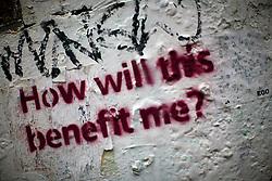 UK ENGLAND LONDON 4NOV12 - Street art 'how will this benefit me?' near Brick Lane and Shoreditch in London's trendy east end.....jre/Photo by Jiri Rezac....© Jiri Rezac 2012