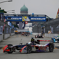 Great Britain's Sam Bird (front) of Virgin Racing Formula E team leads the pack during the FIA Formula E Championship racing series in Putrajaya, Malaysia, 22 November 2014. The second round of Formula E race takes place in Putrajaya on 22 November using cars powered only by electricity.