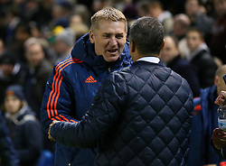 Manager of Brentford, Dean Smith shakes hands with Brighton and Hove Albion Manager, Chris Hughton before the match - Mandatory byline: Paul Terry/JMP - 05/02/2016 - FOOTBALL - Falmer Stadium - Brighton, England - Brighton v Brentford - Sky Bet Championship
