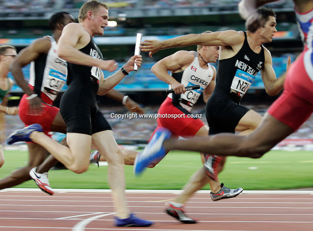 New Zealand runners James Mortimer hands the baton off to James Dolphin in the Men's 4 x 100m final on Day 10 of the XVIII Commonwealth Games at the MCG, Melbourne, Australia on Saturday 25 March, 2006. Photo: PHOTOSPORT